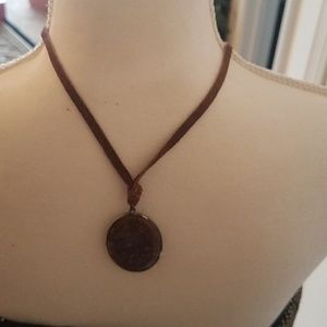 Necklace with leather strap and large stone attach
